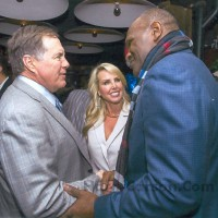 Harry Carson and Bill Belichick shake hands